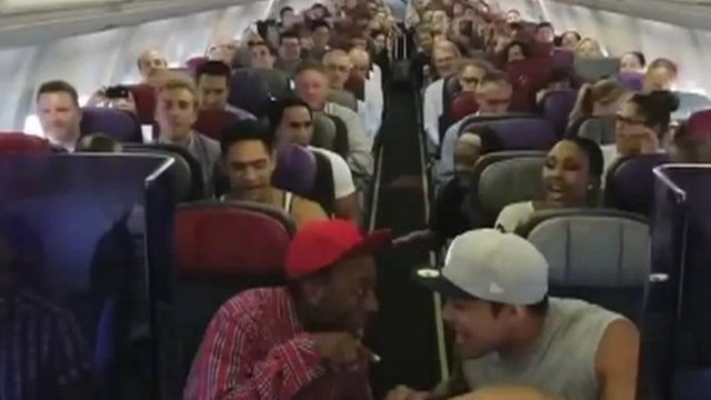 Cast members sing Circle of Life on plane