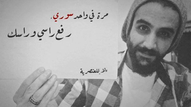 """Lebanese activist Salam Kabboul in a photos with a placard reading in Arabic: """"I once met a Syrian who made us both proud"""""""