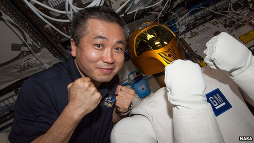 Jaxa's Commander Wakata poses with Robonaut
