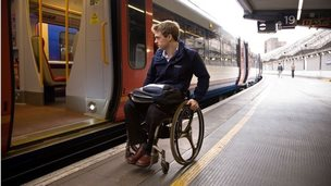 Man in wheelchair at Waterloo station