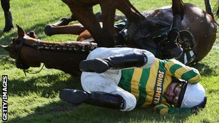 Tony McCoy takes evasive action after falling from Butler's Cabin in the 2008 Grand National