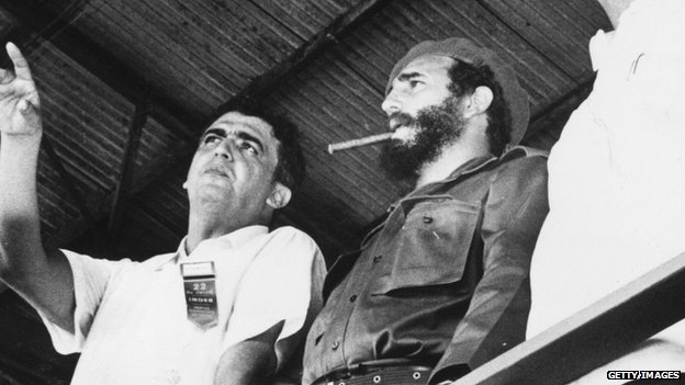 Fidel Castro watches a gymnastics display in Havana in 1962