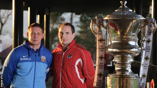 Glenavon defender Kris Lindsay and Crusaders keeper Sean O'Neill with the Irish Cup