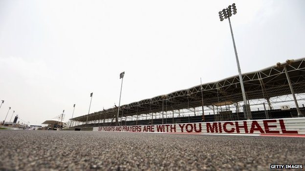 A message of support for former F1 World Champion Michael Schumacher is seen along the armco on the main straight during previews for the Bahrain Formula One Grand Prix