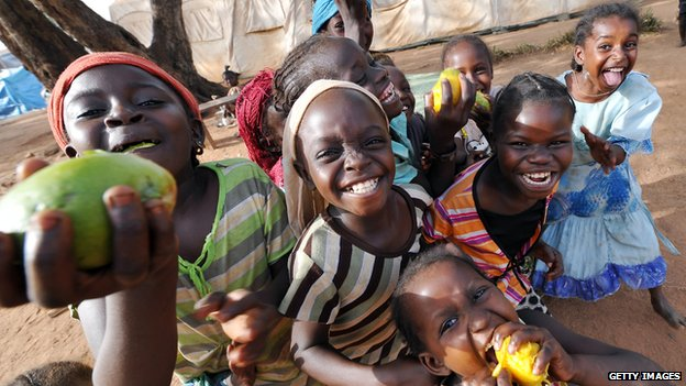 Children from Muslim families who sought refuge in Bossangoa's Freedom school, north of CAR's capital Bangui, eat mangos
