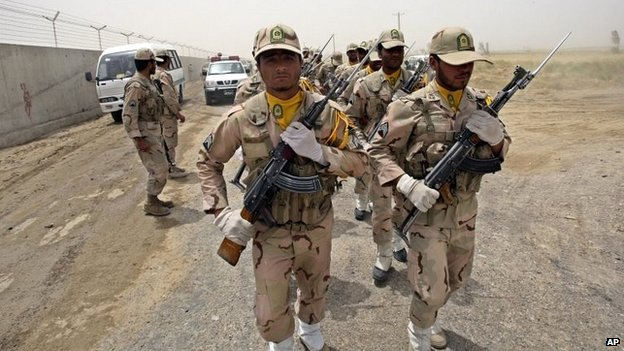 Iranian border guards march near the border with Pakistan and Afghanistan in the Sistan Baluchistan Province
