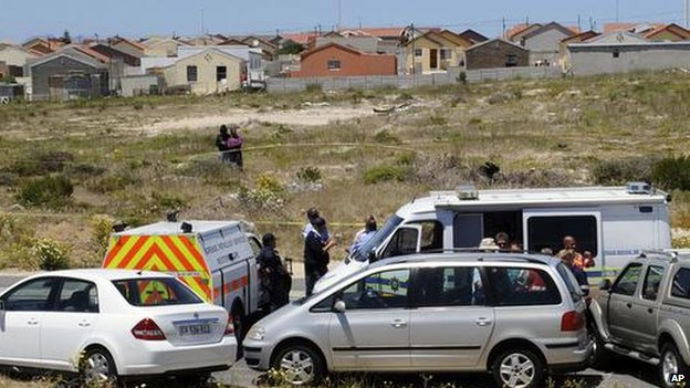 South African police stand by the car (centre) that the body of Anni Dewani was found in the township of Khayelitsha, on the outskirts of the city of Cape Town, South Africa - 14 November 2010