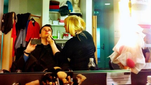 Football commentator Conor McNamara with makeup artist Loretta Parry
