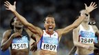 Britain's Kelly Holmes reacts after winning gold in the 800m race at the Athens Olympics in 2004