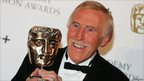 Bruce Forsyth poses with his Academy Fellowship award at the British Academy Television Awards 2008.