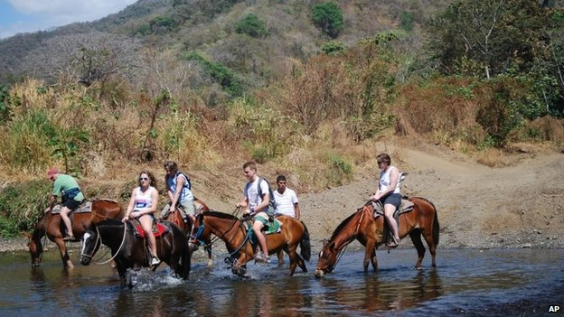 Horseback riders in Nosara, Costa Rica