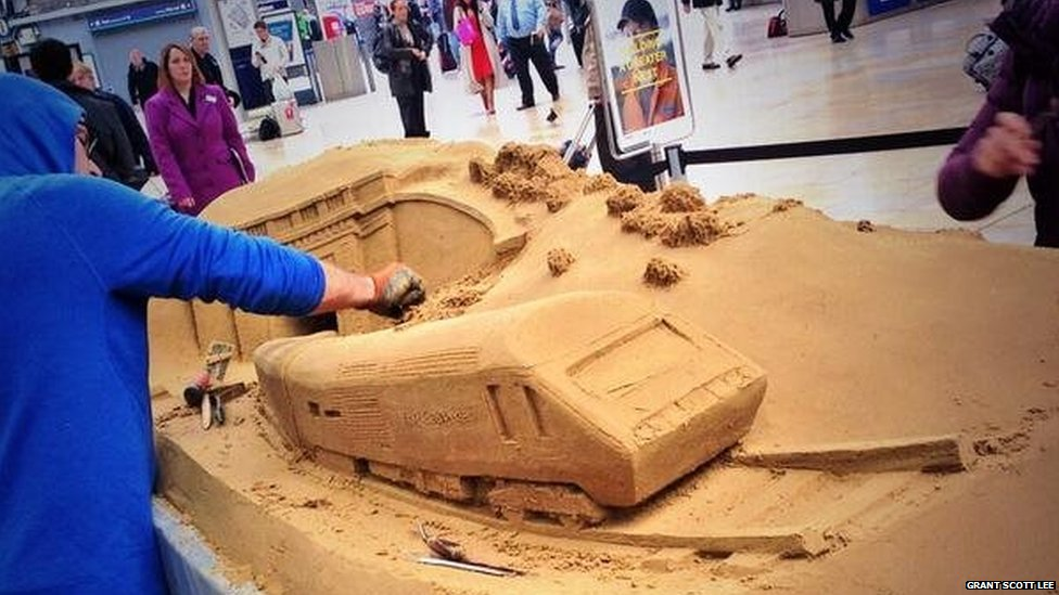 Train sand sculpture being built at Paddington to celebrate the reopening of the rail network in Dawlish