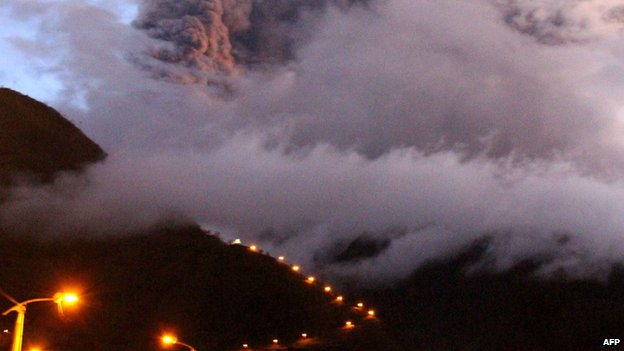The Tungurahua volcano erupting is seen from Banos, Ecuador on April 4