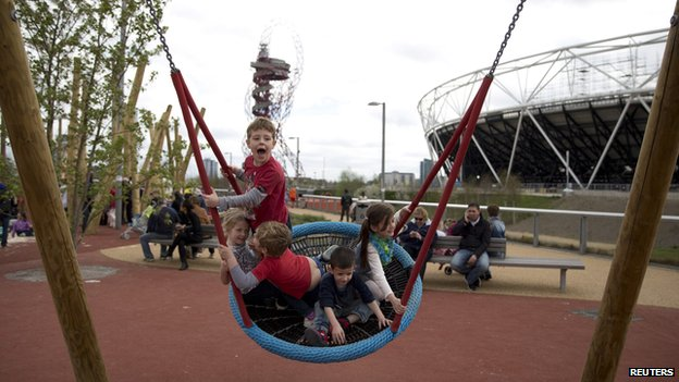 Children play on a swing in the park