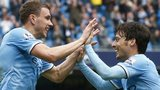 Manchester City striker Edin Dzeko (left) and playmaker David Silva