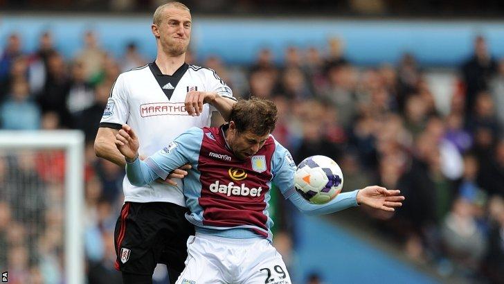 Aston Villa's Grant Holt (front) and Fulham's Brede Hangeland