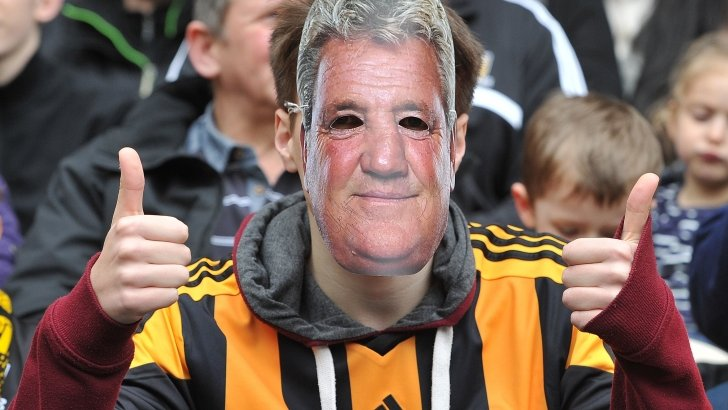 A Hull City fan wearing a Steve Bruce mask