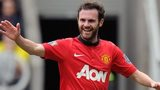 Juan Mata (right) celebrates giving Manchester United the lead at Newcastle