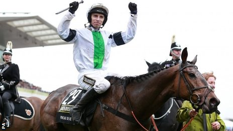 Winning jockey Leighton Aspell celebrates on Pineau De Re
