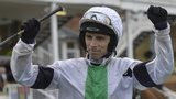 Leighton Aspell celebrates winning the Grand National on Pineau De Re