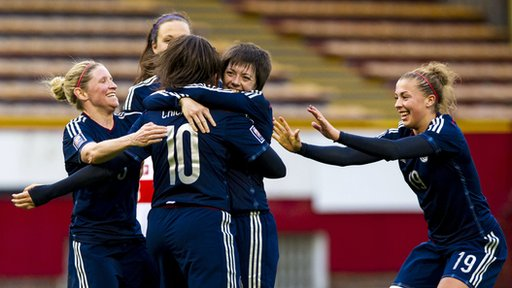Scotland substitute Leanne Crichton is congratulated after doubling their lead at Fir Park