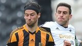 Hull City's George Boyd (left) and Swansea City's Angel Rangel battle for the ball