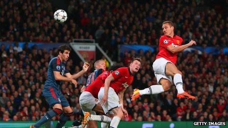 Nemanja Vidic of Manchester United scores against Bayern Munich in the Champions League quarter final