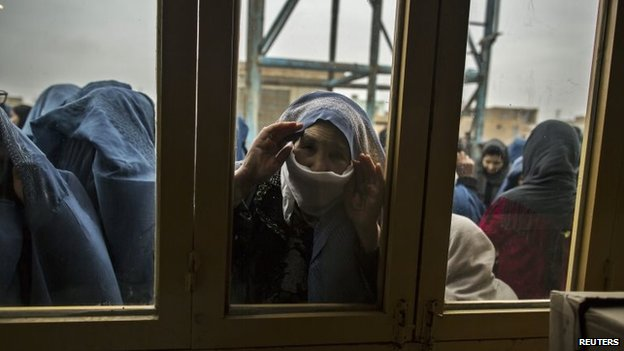 Afghan women wait for their turn to vote at a polling station in Mazar-i-Sharif