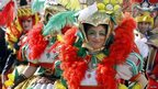 Revellers from Malta wear costumes as they perform at a carnival in Yassmine Hammamet, a Tunisian seaside resort, on 29 March 2014