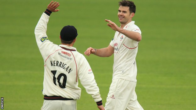 Jimmy Anderson takes a wicket for Lancashire
