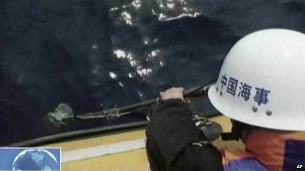 Footage from China's CCTV channel show Chinese search team using an instrument to detect electronic pulses while searching for the missing Malaysia Airlines Flight 370 on 5 April, 2014