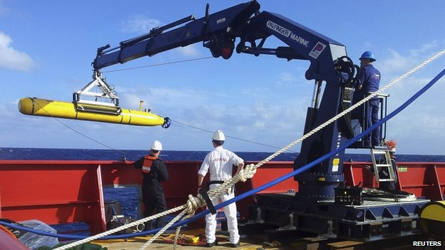 The Bluefin 21 is hoisted back on board the Australian Defence Vessel Ocean Shield after a successful buoyancy test in the southern Indian Ocean as part of the continuing search for the missing Malaysian Airlines flight MH370, in this picture released by the Australian Defence Force on 4 April 2014