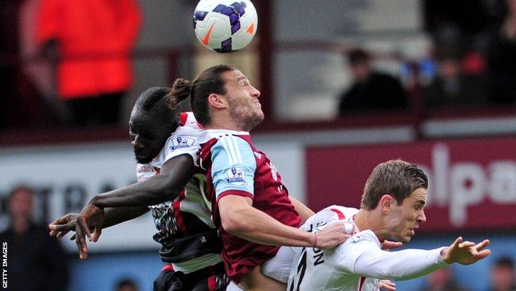 West Ham striker Andy Carroll (centre)