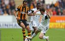 Hull City's Ahmed Elmohamady is tackled by Swansea City's Ben Davies in a match which the home side won 1-0.