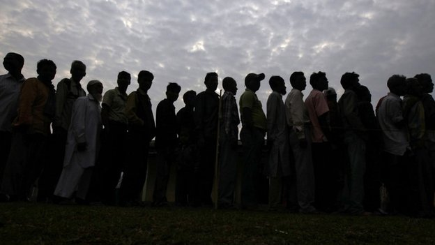 People line up to cast their vote outside a polling station in Nakhrai village in Tinsukia district in the north-eastern Indian state of Assam 7, April 2014.