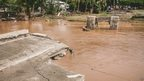 A handout photo taken on 5 April, 2014 shows a washed away bridge in Chinatown in the Solomon Islands capital of Honiara