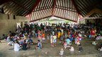 People can be seen at the Panatina Pavilion evacuation centre after severe flooding in the capital Honiara in the Solomon Islands in this picture released by World Vision on 6 April, 2014