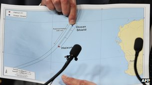 Angus Houston points to a graphic of the search area during a media conference in Perth