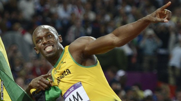 Jamaica's Usain Bolt celebrates after Jamaica won and set a new world record in the men's 4X100 relay final at the athletics event of the London 2012 Olympic Games on August 11, 2012 in London.