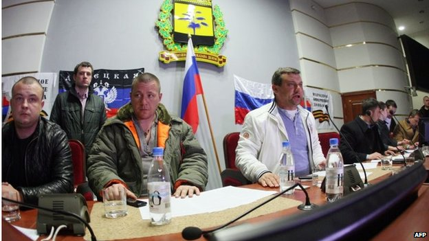 Pro-Russian activists who seized the Donetsk regional government building, take part in a meeting