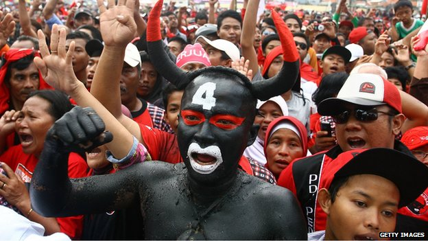 A man dressed as the bull mascot at a rally for Indonesia's Democratic Party of Struggle