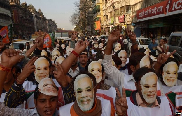 Narendra Modi supporters wearing his masks in a politically rally in India