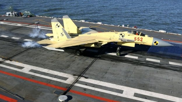 A J-15 fighter jet lands on the Liaoning aircraft carrier