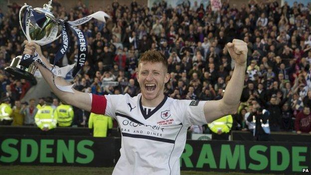 Raith Rovers captain Jason Thomson celebrates with the Ramsdens Cup