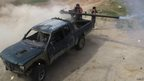 Free Syrian Army fighters launch a rocket