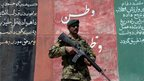 Afghan National Army soldier stands guard