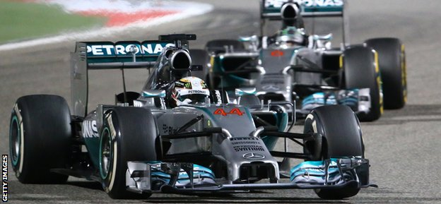 Mercedes AMG Petronas British driver Lewis Hamilton steers his car ahead of his teammate German driver Nico Rosberg during the Formula One Bahrain Grand Prix at Sakhir circuit in Manama on April 6, 2014.