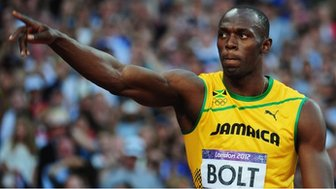 Usain Bolt acknowledges the crowd.