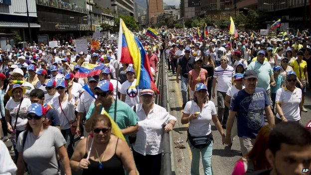 Anti-government demonstrators march in Caracas on 2 March, 2014