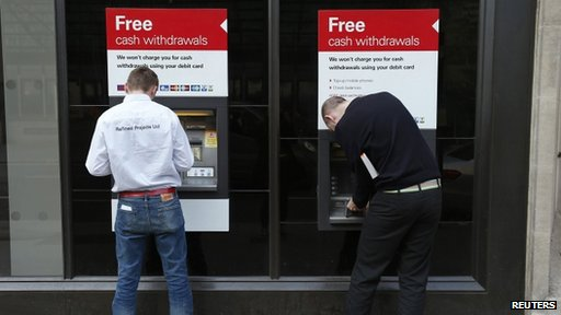 Men using cash machines